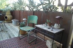 retro & industrial style front porch idea old industrial chair antique side table with wood top dark area rug with multicolored motifs of Add A Comfort Zone in Your Front Porch with These Fabulous Front Porch Seating Ideas