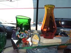 Display window at Fireworks Glass Studios Vases and butterfly by Rhonda Baker, paperweight by Dave Porter