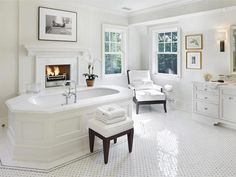Luxury white bathroom with feature fireplace. #homeandstyleliving