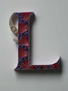 the hearts are cute. quilled letter