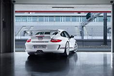 Porsche 911 GT3 RS 4.0 Driving out of Pit Garage Rear View