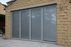 Light grey aluminium bi-fold doors with integral blinds. Blinds For Bifold Doors, Blinds For Windows, Windows And Doors, Window Blinds, Door Window Treatments, Glass Roof, House Extensions, Patio Doors, Home Improvement Projects
