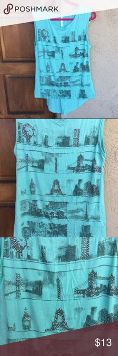 🆕 Landmark Cities Tank ✨Brand New!✨ Lovely mint / teal tank top with various major global city landmarks screen-printed on front & embellished with clear rhinestones for a touch of bling. City names run down the back reading: Paris, Sydney, Chicago, San Francisco, Los Angeles, New York, London & Venice. Comfortable & stretchy. Slight high-low stye. Size L/XL. 96% rayon & 4% spandex. Never worn & no flaws! 🚫No Trades or Paypal. 👍15% off 3+ item bundles! Ocasion Tops Tank Tops
