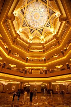 Abu Dhabi City Photos -- National Geographic  A domed ceiling rises over the lobby of the Emirates Palace Hotel.