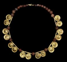 1st century BC. A necklace comprising spherical carnelian beads, gold, Greek.