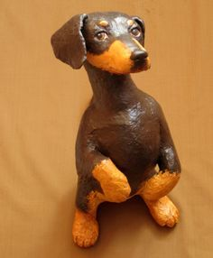 Paper mache dachshund. This is the fifth project in my book Make Animal Sculptures with Paper Mache Clay. My neighbor owns a mini dachshund, and she says he sits up and begs, just like this one.