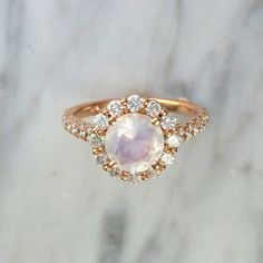 This is a very classic beautiful diamond halo setting adorned with an even more…