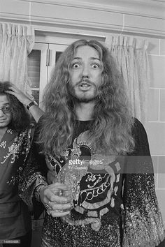singer David Coverdale from rock group Deep Purple posed in Japan in December 1975. Behind him is drummer Ian Paice.