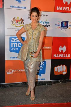 Raai Laxmi wore another outfit by Ms. Chopra: an embellished flared kurta top and dhoti pants