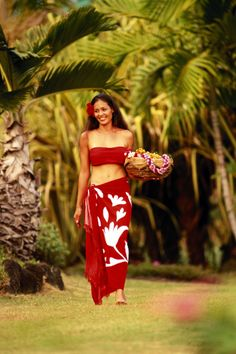 Polynesian woman in a red pareo with a hibiscus