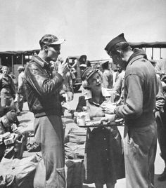 British Red Cross volunteer serving coffee and donuts to GIs
