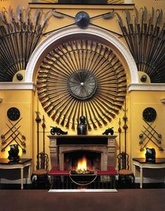 Inveraray Castle: The Armoury Hall Fireplace in the entrance at Inverary.Inveraray Castle is first and foremost a family residence to the Duke and Duchess of Argyll