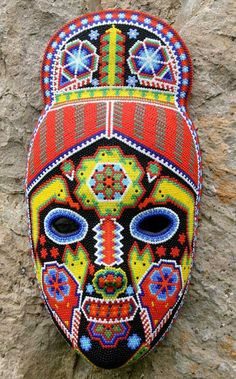 "Artist: Higinio Hernandez Carrillo. Beaded mask, ""Green Jicuri Flower'. ""Huichol indigenous community in the Mexican sierra,"