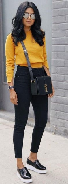Bold colored sweater with all black
