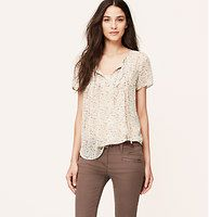 Floral Pleat Blouse - Done in whisper-weight georgette, pretty pleats and organic florals get romantic. Tie neck. Short sleeves. Pleated and ruffled details at front. Back yoke with shirred detail.