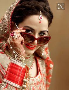 #Beautiful #bridal #with #catty #eye #sunglasses #Mehndi #red #Choora #portrait #time #fun #masti #enjoy #work #captured #by #ZARA #PHOTOGRAPHY