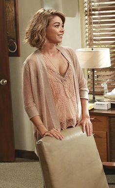 Haley's pink lace v-neck top on Modern Family.  Outfit Details: http://wornontv.net/52986/ #ModernFamily