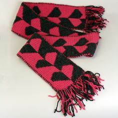 Looking for a Valentine's Day gift? Look no more! I am happy to present you with this warm, beautiful scarf with hearts in pink and black! #accessories #scarf #pink #valentinesday #black #scarves #handknitscarf #knittedscarf #scarfwithfringes