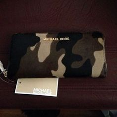 I just discovered this while shopping on Poshmark: Michael Kors Camo wallet (large) NWT. Check it out!  Size: OS