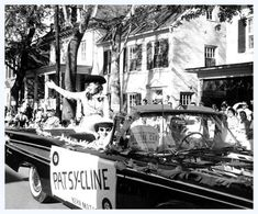 Patsy waves to the crowd as she rides in the 1959 Shenandoah Apple Blossom Festival Grand Feature Parade.