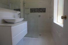 Wall hung vanity and white basin for a modern style bathroom #bathroomvanitiesandbasins