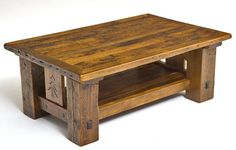 Pine trees are handcarved on each end of this barnwood coffee table. Thick barn wood beams with over 100 years of natural blemishes and texture give this coffee table added character. A thick shelf can handle all the magazine you can stack.  This design is available in custom sizes. Measure your space, and we will make