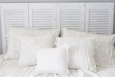 DIY headboard transformed from an old louvered closet door into a chalk painted and distressed shabby chic beauty!