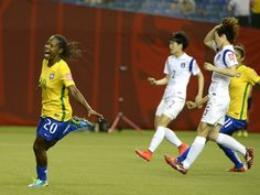Brazil's Formiga, left, celebrates a shot for a goal as Korea Republic defender Kim Doyeon, right, reacts in the first half of their Group E soccer match in the FIFA women's World Cup in Montreal.  Eric Bolte, USA TODAY Sports