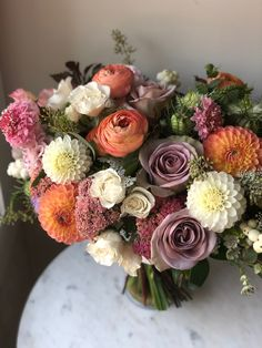 Our September couple chose dusty mauve, peach/coral and white as their wedding colour palette and the result was striking! Flowers used were #amnesiaroses , #dahlias , snowberries, yarrow and scabiosa. #canmore #canmorewedding #mauveflowers #dustypeach #peachflowers #whitedahlias #coralflowers #septemberweddingideas #fallweddingflowers #fallweddingbouquet #calgaryflorist #calgaryflowers #flowersbyjanie