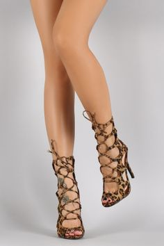 """Breckelle Leopard Caged Corset Lace Up Heel. Description This fashionable leopard print vegan suede upper, caged cutout design vamp, peep toe silhouette, corset-style lace up detail, and stiletto heel. Finished with lightly padded insole and rear zipper closure for easy on/off.Material: Vegan Suede (man-made)Sole: Synthetic Measurement Heel Height: 4.6"""" (approx)Shaft Length: 10"""" (including heel)Top Opening Circumference: 14.25"""" (approx)"""