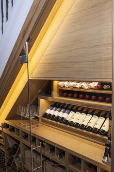 Cellar Maison classic under stairs wine wall featuring natural oak joinery and i. Oak Wine Rack, Wine Rack Wall, Wine Wall, Stairs Feature Wall, Feature Wall Design, Mini Bars, Under Stairs Wine Cellar, Home Wine Cellars, Wine Cellar Design