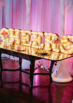 """Fab """"cheers"""" sign from Innovative Event Solutions. Styled shoot by Emerson Events. Draping from Mood Party Rentals. Furniture from Soiree Event Rentals. Photo by Amanda Watson Photography. #wedding #cheers #lighting"""