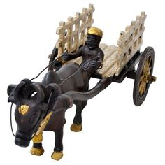 Ethnic Brass Bullock Cart - Interesting artifacts always help in creating a striking look for the home interiors and this fabulously designed bullock cart is no exception. Further, the brass material makes it a worthy pick.