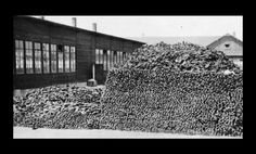 large pile of victims shoes, Dachau after liberation.