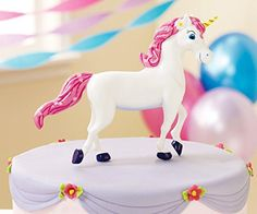 "Enchanted Unicorn Cake Topper is made of plastic, 5"" long."