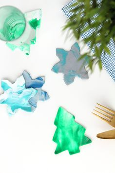 Add a little holiday cheer to your party (and save your furniture) with these DIY clay coasters!