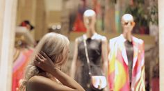 Woman Looks Admiringly At The Windows Of Boutiques In The Milan Filmati e video d'archivio 12959870 - Shutterstock