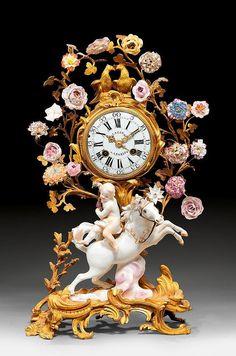 IMPORTANT CLOCK WITH PORCELAIN FIGURES, Louis XV, the dial and movement signed LACAN A PARIS (Henry Lacan, maitre 1756), the figures by J.J. KANDLER (Johann Joachim Kandler, 1706-1775), Paris circa 1760.