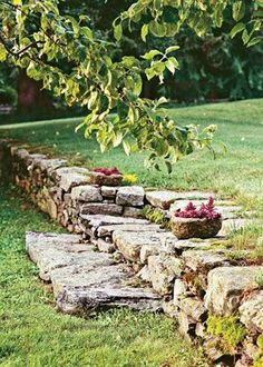 A rustic stone wall bridges the gap in the split-level landscape on my cottage property. I have loved stones since touring New England and made this wall to resemble what I saw there.