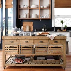 Love this kitchen island with crate-style drawers.