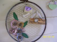 Love the barrel ring and chicken wire.  I would use different embellishments.