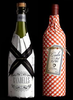Love this red gingham paper wrapping and vintage-inspired strawberry label for a sweet red wine