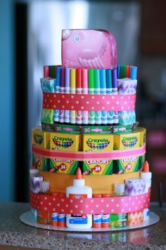 Kid's gift - art supply cake. Maybe a centerpiece for a bday party and each of the kids get a section as a favor??