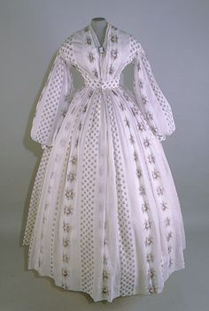 Date Made: c.1860-65 white and purple cotton print dress with v-neck.