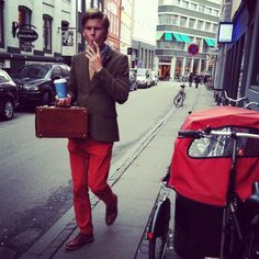 Hipster wearing red trousers