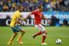 Sebastian Larsson (left) is pipped to the ball by Wales' midfielder Vaughan in Stockholm... #Seb