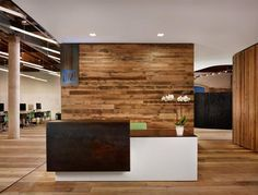Like the wood accent wall behind the reception desk - B