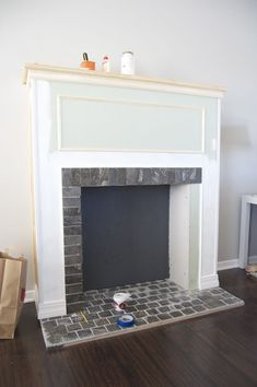 DIY ~ Building A Faux Fireplace would like to do this! especially for the holdidays. Love the stone insert