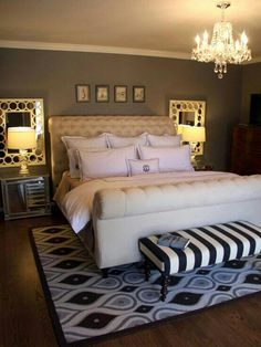 Love the color contrasts, Mirrors behind nightstands, bench at the end of the bed and the area rug~ Master Bedroom Decor