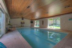 Elegant Swimming Pool With Rustic Ceiling Design